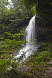Waterfall with Path Going Behind It. Dry Falls, also known as Upper Cullasaja Falls, is a 65-foot waterfall located in the Nantahala National Forest, northwest Royalty Free Stock Images