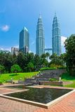 Petronas Towers surrounded by tropical and rain forest