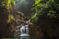 Waterfall, Phliu. The 3-level Phliu waterfall features a basin of cool, clear water for splashing around and plenty of fish make the flowing streams their home Stock Images
