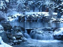 Waterfall pond. Winter pond with waterfalls and snow Royalty Free Stock Photos