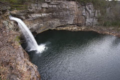 Waterfall and Pond. Outdoor landscape of a waterfall and a pond or lagoon surrounded by rocky cliffs...DeSoto Falls in Alabama Stock Photography