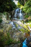 Waterfall with pool in tropical jungle, Na Muang, Royalty Free Stock Photo