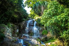 Waterfall with pool in tropical jungle, Na Muang, Stock Image