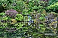 Waterfall at Portland Japanese Garden. Waterfall and Reflection at Portland Japanese Garden in Spring royalty free stock photos