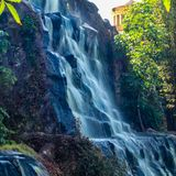 Waterfall in a public park in Guadalajara Jalisco Mexico on a sunny day. Wide wall with waterfall in a public nature park in Guadalajara Jalisco Mexico on a royalty free stock photography