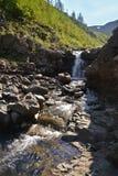 Waterfall on the Putorana plateau. Royalty Free Stock Photo