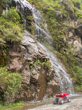Waterfall And Quad Bike Royalty Free Stock Images