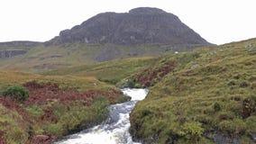 Waterfall at the Quiraing mountain pass road - Isle of Skye, Scotland. UK stock footage