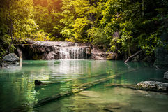 Waterfall in rain forest in summer, the warmest season of the year in Thailand Stock Photo