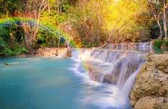 Waterfall in rain forest. Wit rainbow (Tat Kuang Si Waterfalls at Luang prabang, Laos Stock Images