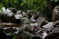 Waterfall after rain. waterfall in the forest. Abstract stone with waterfall in Chonburi, Thailand. waterfall after rain. waterfall in the forest Royalty Free Stock Photos
