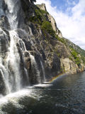 Waterfall and Rainbow. Beautiful waterfall in the Lysefjord, with a little rainbow besides Royalty Free Stock Images