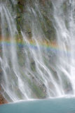 Waterfall with rainbow Stock Image