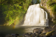 Waterfall with rainbow Stock Photo