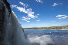 Waterfall, rainbow and Canaima Lagoon, Venezuela Royalty Free Stock Photography