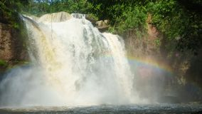 Waterfall with rainbow in deep forest on rainy day at Khoa Yai n. Ational park, thailand Stock Photo