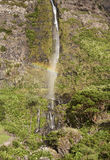 Waterfall and rainbow in Flores island, Azores. Poco do Bacalhau Royalty Free Stock Image