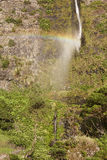 Waterfall and rainbow in Flores island, Azores. Poco do Bacalhau Royalty Free Stock Images