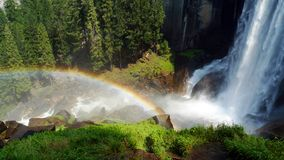 Waterfall and rainbow of Vernal Fall in Yosemite. Waterfalls and rainbow of the Vernal Fall in Yosemite National Park, California, United States Royalty Free Stock Photography