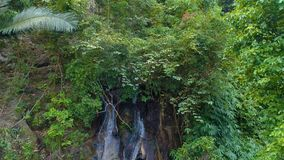 Waterfall in the rainforest.  Aerial. Thailand. Water falls from a height of 30 meters stock video
