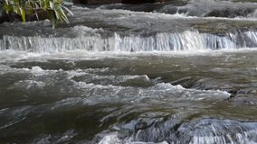Waterfall in rainy season stock video footage