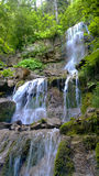 Waterfall. Rapidly falling water flow Stock Photos