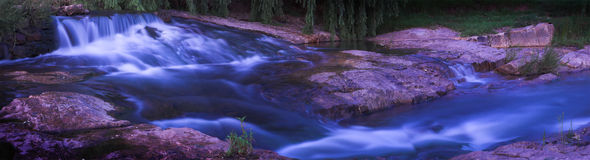 Waterfall and rapids. Waterfall panoramic scenic with blurred rushing pure clean water Stock Photography