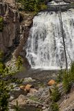 Waterfall rapids. Closeup landscape nature shot of water rushing rapids in a waterfall taken at yellowstone national park in wyoming royalty free stock photography