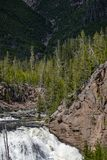 Waterfall rapids. Closeup landscape nature shot of water rushing rapids in a waterfall taken at yellowstone national park in wyoming stock photos