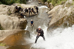 Waterfall Rappelling On Canyoning Adventure Stock Photos