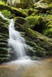 Waterfall from ravine Stock Photography