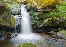 Waterfall from ravine Stock Image