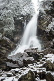Waterfall from ravine in winter, long exposure Stock Image