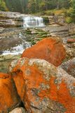 Waterfall with red stones Stock Images