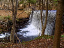 Waterfall at the Reservoir. Water flowing in from the little water fallat the local reservoir in Seymour, CT Royalty Free Stock Images
