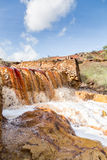 Waterfall in Riotinto mining area, Andalusia, Spain Stock Photos