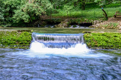 Waterfall of river Bosna near Sarajevo. Spring of the Bosna river, small waterfall and park Vrelo Bosne near Sarajevo - Bosnia and Herzegovina royalty free stock image