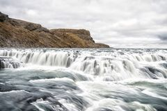 Waterfall in river canyon in Iceland Royalty Free Stock Photo