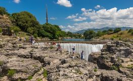 Waterfall on the river Cijevna and tourists. Waterfall on the river Cievna and tourists. Montenegro Royalty Free Stock Photo