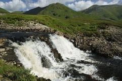 Waterfall on River Cluanie. With Cluanie Lodge Bridge Stock Photo