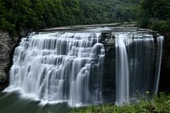 Waterfall. A river flows to a drop off and falls below creating a beautiful sight Stock Images