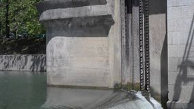 Waterfall on the river gateway. The mechanism for lifting the gate. Ljubljana, Slovenia stock video
