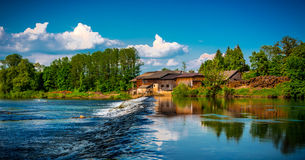Waterfall on the river-Kolpa. Waterfall on the river Kupa in the background and saw trees with blue sky and clouds kolpa Royalty Free Stock Photography