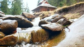 Mountain river house. Waterfall that is river in mountain stock video