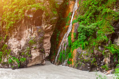 Waterfall and river in Nepal Royalty Free Stock Images