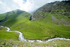 Waterfall and river in Tien Shan, Kyrgyzstan Stock Image