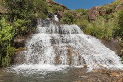 Waterfall on the road to the Sani Pass border post Royalty Free Stock Photo