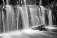 Waterfall with a rock, long exposure - shot with analogue film. A nice little waterfall captured with a long exposure. Location: Uddevalla, Sweden Image is taken royalty free stock photos