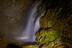 Waterfall rock night backlight Royalty Free Stock Images