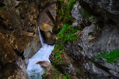 Waterfall and rock wall Stock Images